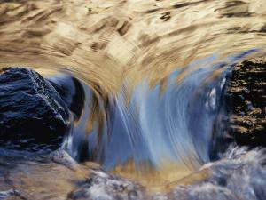 Water Flows Swiftly Between Two Rocks by Jason Edwards