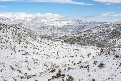Atlas Mountains landscape during winter snow, Ouarzazate Province, Souss-Massa, Morocco, North Afri by Jason Langley