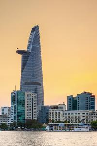 Bitexco Financial Tower and central Ho Chi Minh City (Saigon) skyline at sunset, Vietnam by Jason Langley