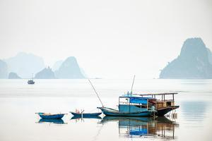 Boats in Bai Tu Long Bay on a foggy day, Cai Rong, Quang Ninh Province, Vietnam by Jason Langley