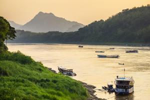Boats on the Mekong River in late afternoon, Luang Prabang, Louangphabang Province, Laos by Jason Langley