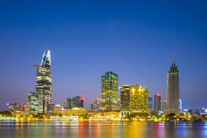 Central Ho Chi Minh City (Saigon) skyline and Saigon River at dusk, Vietnam by Jason Langley