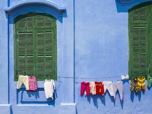 Clothes hung out to dry on a blue wall, Hoi An, Quang Nam Province, Vietnam by Jason Langley
