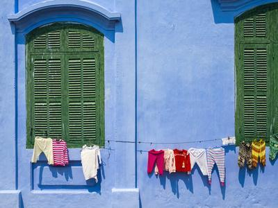 Clothes hung out to dry on a blue wall, Hoi An, Quang Nam Province, Vietnam