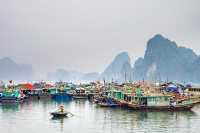 Colorful fishing boats in the harbor at Cai Rong, Quang Ninh Province, Vietnam