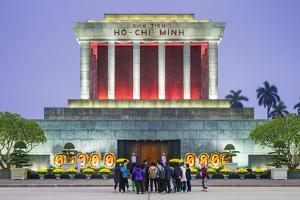 Crowd of tourists in front of Ho Chi Minh Mausoleum on Ba Dinh Square at night, Hanoi, Vietnam by Jason Langley