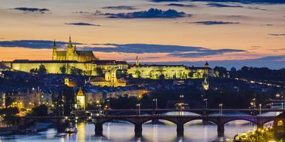 Czech Republic, Prague. Prague Castle, Pazsky Hrad, and the Vltava River at sunset from the Vysehra