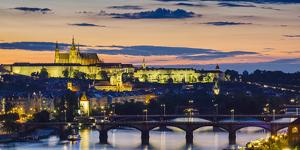 Czech Republic, Prague. Prague Castle, Pazsky Hrad, and the Vltava River at sunset from the Vysehra by Jason Langley