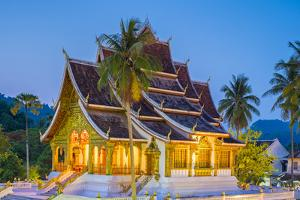 Haw Pha Bang temple on the grounds of the Royal Palace Museum in Luang Prabang at night, Louangphab by Jason Langley