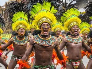 Men in traditional dress at Dinagyang Festival, Iloilo City, Western Visayas, Philippines by Jason Langley
