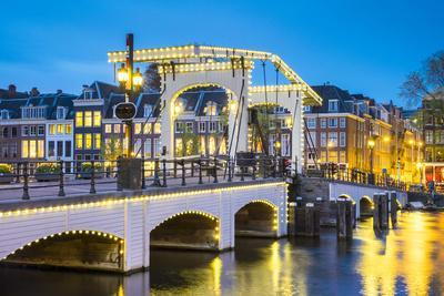Netherlands, North Holland, Amsterdam. Magere Brug, Skinny Bridge, on the Amstel River at night.