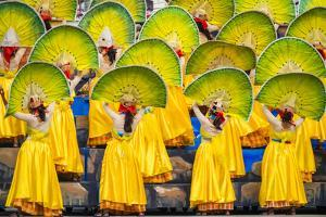 Participants perfrom at Dinagyang Festival, Iloilo City, Western Visayas, Philippines by Jason Langley