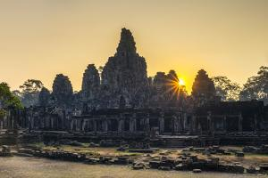 Prasat Bayon temple ruins at sunrise, Angkor Thom, UNESCO World Heritage Site, Siem Reap Province,  by Jason Langley