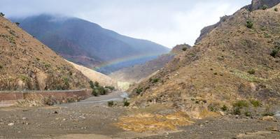 Rainbow in a gorge, Tizi N'Tichka pass in the Atlas Mountains, Al Haouz Province, Marrakech-Safi re by Jason Langley