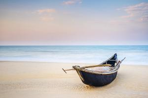 Traditional bamboo basket fishing boat on the beach at sunset, Thuan An Beach, Phu Vang District, T by Jason Langley