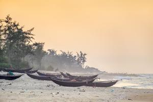 Traditional bamboo basket fishing boats on the beach at sunset, Thuan An Beach, Phu Vang District,  by Jason Langley