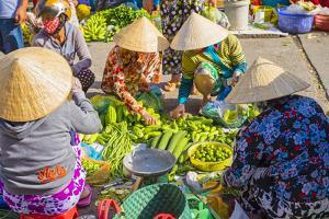 Vietnamese women buying and selling vegetables at An Binh market, Can Tho, Mekong Delta, Vietnam by Jason Langley