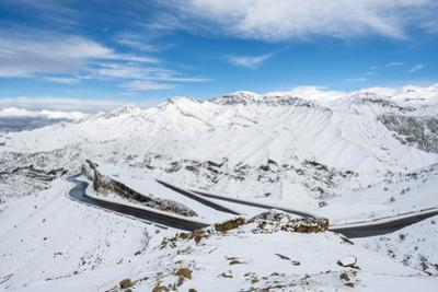 Winding road through Tizi N'Tichka pass in the Atlas Mountains during winter snow, Marrakech-Safi,  by Jason Langley
