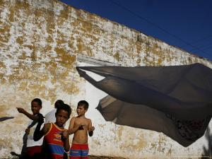A Group of Children Fly Plastic Bags, Known as Papalotes by Javier Galeano