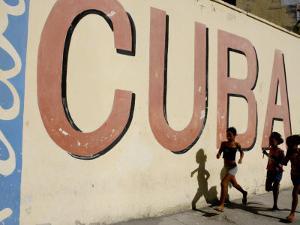 Cuban Girls Run in a Street in Havana, Cuba, Thursday, August 10, 2006 by Javier Galeano