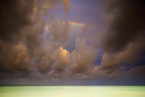 Rainbows & Storm Clouds Over Emerald Green Waters Of Caribbean Ocean, Playa Del Carmen Mexico by Jay Goodrich