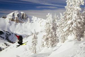 Skier Gets Some Classic Air With Cody Peak In The Background Sunrise Top Of Rendezvous Bowl At JHMR by Jay Goodrich