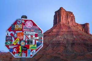Stickers Cover A Stop Sign Near Castle Valley State Park In Utah by Jay Goodrich