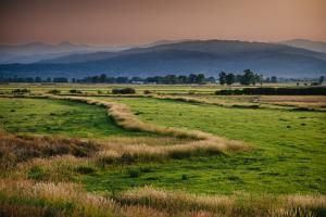 Summer Wildfires Create Hazy Conditions Sunset Over Looking The Ranch Lands South Of Jackson, WY by Jay Goodrich