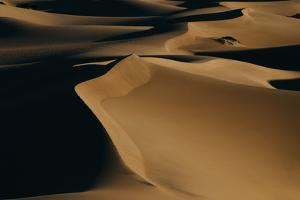 Sunrise Over The Mesquite Dunes In Death Valley National Park by Jay Goodrich