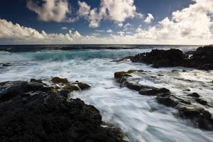 The Blue Hues Of The Pacific Ocean Wash In And Out Along Highway 137 On The Big Island Of Hawaii by Jay Goodrich