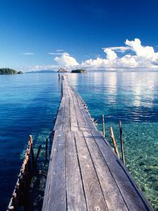 Wooden Jetty Extending off Kadidiri Island, Togian Islands, Sulawesi by Jay Sturdevant