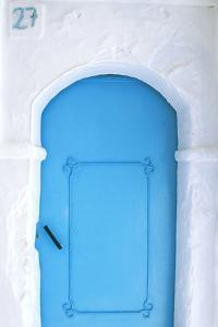 Africa, Morocco, Chefchaouen. Blue door in white building. by Jaynes Gallery