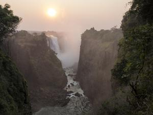 Africa, Zimbabwe, Victoria Falls. View of Waterfalls at Sunrise by Jaynes Gallery
