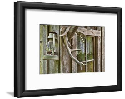 Antlers and Lantern Hanging on Rustic Home, Stehekin, Washington, USA