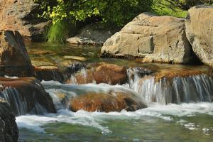 Canada, Alberta, Lethbridge. Waterfall in Nikka Yuko Japanese Garden. by Jaynes Gallery