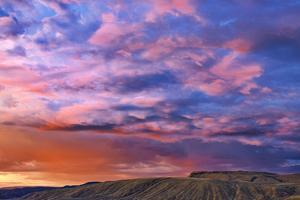 Canada, British Columbia, Cache Creek. Stormy clouds over prairie at sunrise. by Jaynes Gallery