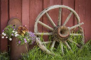 Canada, British Columbia, Cache Creek. Vintage wagon wheel. by Jaynes Gallery