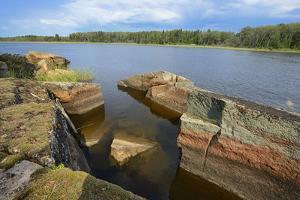 Canada, Manitoba, Winnipeg. Rocky shoreline along Bloodvein River. by Jaynes Gallery
