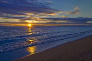 Canada, Manitoba, Winnipeg. Sunrise on Lake Winnipeg beach. by Jaynes Gallery