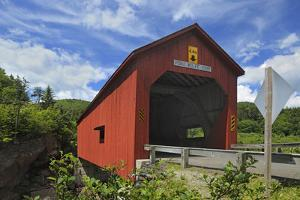Canada, New Brunswick, Fundy National Park. Red covered bridge at Point Wolfe. by Jaynes Gallery