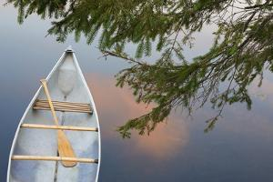 Canada, Quebec, Eastman. Canoe on Lake at Sunset by Jaynes Gallery