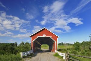 Canada, Quebec, Ste. Jeanne d'Arc. Covered bridge over stream. by Jaynes Gallery