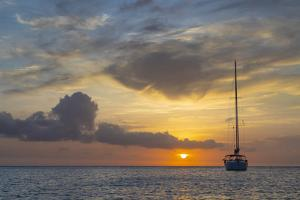 Caribbean, Grenada, Mayreau Island. Sailboat at anchor at sunset. by Jaynes Gallery