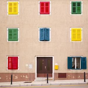 Croatia, Vrsar. Building with colorful shutters. by Jaynes Gallery