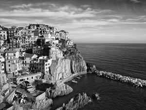 Europe, Italy, Manarola. B&W of Hillside Town Overlooking Ocean by Jaynes Gallery