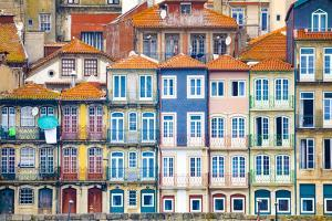 Europe, Portugal, Porto. Colorful building facades next to Douro River. by Jaynes Gallery