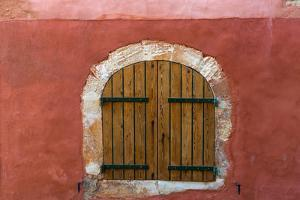 France, Provence, Roussillon. Wooden shutters in red wall. by Jaynes Gallery