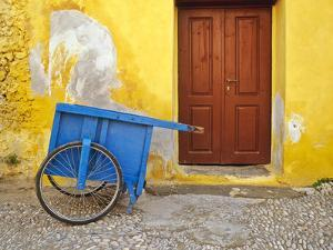 Greece, Rhodes. House with blue cart in front. by Jaynes Gallery