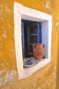Greece, Santorini, Oia. Pottery in window. by Jaynes Gallery