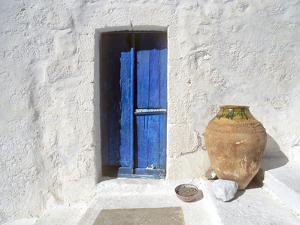 Greece, Symi. Blue door and pot. by Jaynes Gallery
